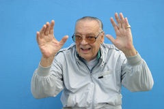 Senior man waving his hands Royalty Free Stock Photography