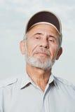 Senior man wearing a baseball cap Stock Photos