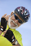 Senior Man Wearing Gloves Stock Photography