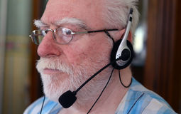 Senior man wearing headset Royalty Free Stock Photo