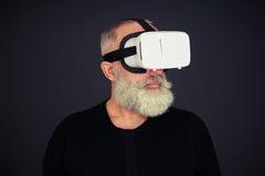 Senior man wearing hi-tech VR headset Stock Photos