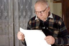 Senior man wearing reading glasses Stock Image