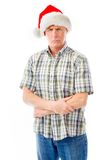 Senior man wearing Santa hat and looking upset Stock Photos
