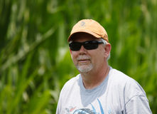 Senior Man Wearing Sunglasses Outdoors. Senior man wearing baseball cap and sunglasses outside in nature Stock Photos