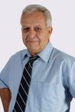 Senior man wearing tie. Portrait of mature elderly man wearing blue dress shirt and tie royalty free stock images
