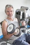 Senior man with weights Stock Images