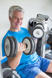 Senior man with weights Royalty Free Stock Photography