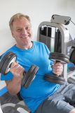 Senior man with weights Stock Photography