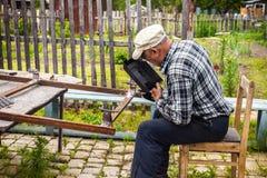 Senior man welding metal structure Stock Image