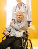 Senior man in wheelchair Stock Photos