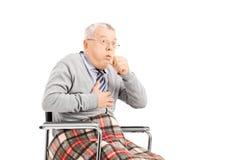 Senior man in wheelchair, choking. Senior man in wheelchair choking isolated on white background Stock Images