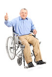 Senior man in a wheelchair giving a thumb up Royalty Free Stock Images