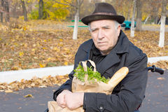 Senior man in a wheelchair with his groceries royalty free stock photo
