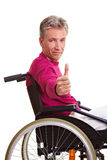Senior man in wheelchair holding Royalty Free Stock Photos