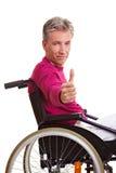 Senior man in wheelchair holding Royalty Free Stock Photos