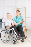 Senior man in wheelchair lifting dumbbells Royalty Free Stock Images