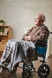 Senior man on wheelchair Royalty Free Stock Photography