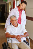 Senior man in wheelchair with nurse Stock Photography
