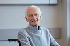 Senior man on wheelchair Stock Photos