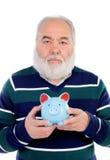 Senior man with white beard and a blue moneybox Royalty Free Stock Photos