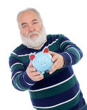 Senior man with white beard and a blue moneybox Royalty Free Stock Photography