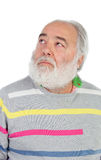 Senior man with white beard lookin up Stock Photo
