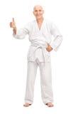 Senior man in a white kimono giving a thumb up Royalty Free Stock Photos