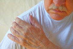 Aching shoulder of man Royalty Free Stock Image