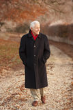 Senior Man On Winter Walk Through Frosty Landscape Stock Photos