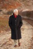 Senior Man On Winter Walk Through Frosty Landscape Stock Photos