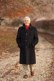 Senior Man On Winter Walk Through Frosty Landscape Royalty Free Stock Image