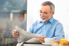 Free Senior Man With A Newspaper Stock Photo - 36815650