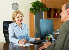 Senior Man With Bank Manager Stock Photo