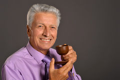 Senior Man With Cup Of Coffee Stock Images