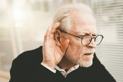 Free Senior Man With Hearing Problems Stock Photos - 152916003