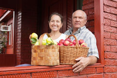 Senior man and woman with apples Stock Photos