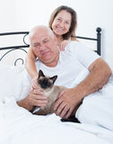 Senior  man and   woman  on   bed Royalty Free Stock Photos