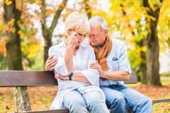 Senior man and woman being sad. Senior men and women having being sad embracing each other Royalty Free Stock Photos