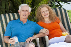 Senior Man and Woman Couple Enjoying Drinks Stock Photo