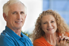 Senior Man and Woman Couple Holding Hands royalty free stock photos