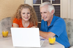 Senior Man and Woman Couple On Laptop Computer Royalty Free Stock Images