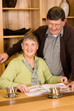 Senior man and woman couple looking at brochure Stock Photos