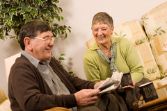 Senior man and woman couple reading newspaper Royalty Free Stock Image