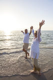 Senior Man & Woman Couple Sunset on Beach Stock Photos