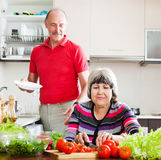 Senior man  and  woman  doing chores Royalty Free Stock Images