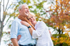Senior man and woman embracing each other in love Royalty Free Stock Photos