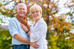 Senior man and woman embracing each other in love Stock Image