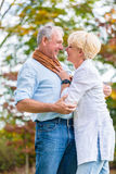 Senior man and woman embracing each other in love Royalty Free Stock Image