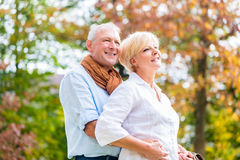 Senior man and woman embracing each other in love Royalty Free Stock Photo