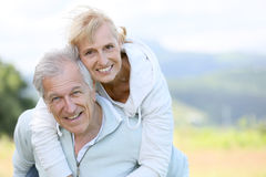 Senior man and woman having fun in countryside Stock Photos